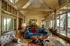 large room with vaulted ceiling and large view windows